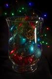 Dekorativ vas som fylls med julprydnader Arkivbild