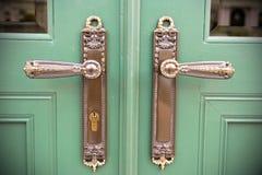 Dekorativa dörrhandtag Fotografering för Bildbyråer