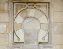 Dekorativa modeller på stenväggen Fotografering för Bildbyråer