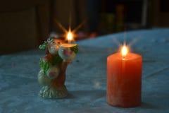 Dekorativa stearinljus med det ljusa filtret för stjärnor arkivfoton