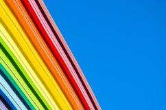 Dekorative Elemente des Regenbogens und des blauen Himmels Stockfotos
