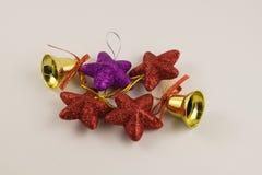 Dekorative Glocken und Sterne für Weihnachten und neues Jahr Lizenzfreie Stockbilder