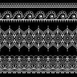 Dekorative nahtlose schwarze vertikale Blumengrenzen in Hennastrauch mehndi Art für Tätowierung oder Karte Stockbilder