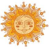 Dekorative Sonne mit menschlichem Gesicht Stockbild