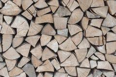 Dekorative Wand des Brennholzes Stockfotografie