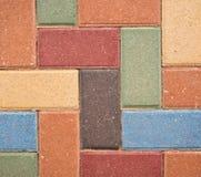 Dekorativer farbiger Ziegelstein-Hintergrund Stockfotografie