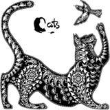 Dekoratives grafisches Bild, eine Katze, die mit einem Vogel spielt Stockbilder