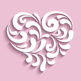 Dekoratives Herz mit Papierstrudeln Stockbild