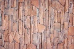 Dekorativt färgrikt brunt abstrakt begrepp för textur för stenvägg för bakgrund arkivbild