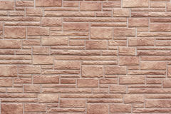 Dekorativt slut för tegelstenvägg upp som bakgrund eller textur arkivbilder