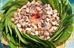 Dekorerad arecamutter, betel - muttern tuggade med betelbladet Arkivfoton