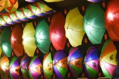 Dekorerad färgrik paraplybakgrund royaltyfria foton