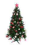 Dekorerad julgran med patchworkprydnaden Arkivbilder