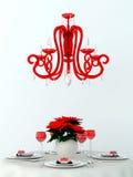 Dekorerad tabell och en röd lampa fotografering för bildbyråer