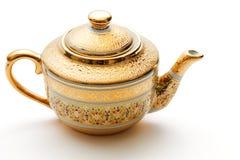 dekorerad utsmyckad teapot för guld arkivbilder