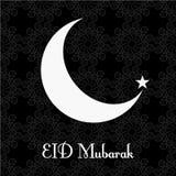 Dekorerade det svartvita hälsningkortet för tappning för den Eid Mubarak festivalen, den växande månen på vit bakgrund för muslim arkivfoton