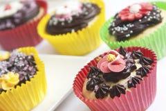 dekorerade muffiner Arkivfoto