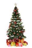 Dekorerat julträd med gåvor på vit Arkivbild