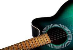 Del av den akustiska svart och grön färgen för gitarr som, isoleras på a Arkivbild