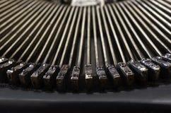 Del av den bärbara skrivmaskinen för tappning med bokstäver Arkivbild