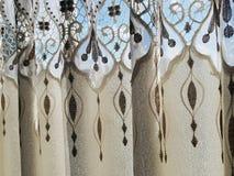 Del av den beautifully draperade gardinen Royaltyfri Foto