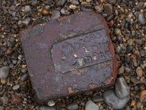 Del av tegelsten på stranden, Weston Super Mare arkivfoton