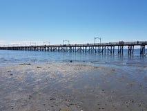 Del embarcadero playa del agua de la arena del océano a.C. Fotografía de archivo