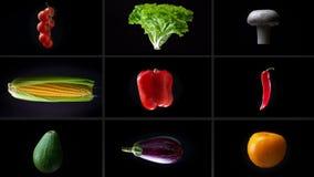 Del enfoque montaje hacia fuera de hacer girar verduras diversas mojadas, en un fondo blanco, collage almacen de video