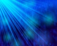 Del fondo de la luz y del brillo del bokeh azul abstracto profundamente Foto de archivo