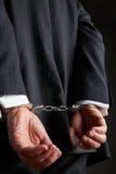 Del hombre de negocios de With Hands Cuffed parte posterior detrás Imagenes de archivo
