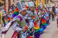 Del mascarado Carmen Pisac Cuzco Peru de Virgen dos dançarinos Imagem de Stock Royalty Free