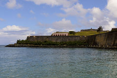 Del Morro Promenade and Walk Way. A view across the bay of San Juan to the Del Morro Promenade (Walk Way or Path) that follows the walls and fortifications of Stock Photo