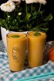 Del plátano todavía del jugo vida anaranjada hecha en casa Fotos de archivo