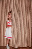 Dela girl behind curtain Stock Photos