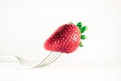Dela sig och jordgubben Arkivfoto