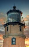 delad solnedgång för fyrrock Arkivfoto