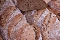Delail of Brown bread. A slice of healthy brown bread on a breadboard Royalty Free Stock Image