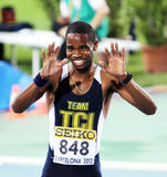 Delano Williams celebrates winning of 200 meters Stock Photos