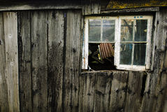 Delapidated. An old shed in need of repair and used to store a load of junk royalty free stock photography