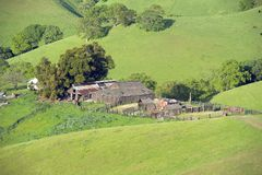 Delapidated farmhouse in a green valley Royalty Free Stock Photos