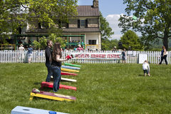Delaplane, Virginia, USA-May 24, 2014: People playing corn hole at the Delaplane Strawberry Festival at Sky Meadows State Park. In Delaplane, Virginia in stock photos