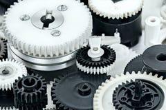 Delar av industriell mekanism plast- svartvitt kugghjul Arkivbilder