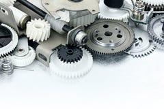 Delar av industriell utrustning plast-kugghjul och kugghjul på sc Arkivbild
