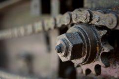 Delar av kedjan och kugghjulet Arkivfoton