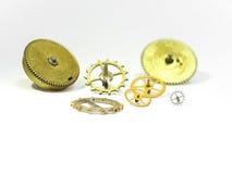 Delar av små och stora kugghjul för timmar Arkivfoton