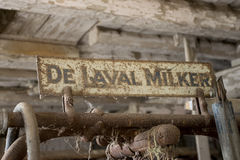 DELAVAL MILKER RUSTY SIGN IN MILKING PARLOR Stock Images