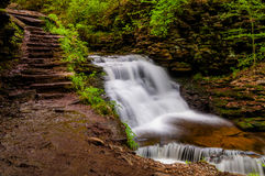 Delaware Falls and stairs along the Falls Trail in Ganoga Glen, Ricketts Glen State Park Royalty Free Stock Photography