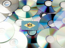 Delaware flag on top of CD and DVD pile isolated on white Stock Photo