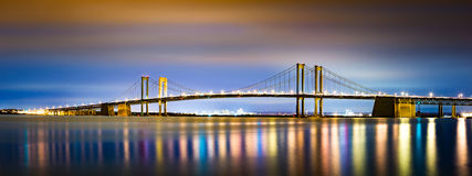 Delaware Memorial Bridge by night. Viewed from New Jersey. The Delaware Memorial Bridge is a set of twin suspension bridges crossing the Delaware River between Stock Photos