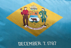Delaware State Flag. A close-up of the Delaware State Flag waving in the wind stock image